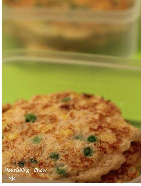 Savoury pikelets with parmesan cheese, corn and peas