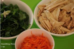 Rehydrated tofu skin (top right), grated carrots, coriander and spring onion