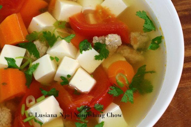 Nourishing tofu, pork, carrot and tomato soup