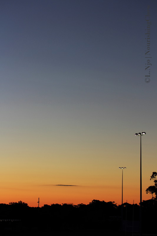 sunset sky, post lights, lamp post